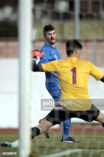Gaetano Monachello of Italy U20 scores the opening goal during the international friendly match between Italy U20 and Qatar U20 on February 25 2015...