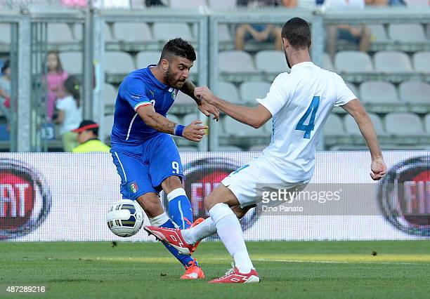 Gaetano Monachello of Italy U21 competes with Kenan Bjric during the 2017 UEFA European U21 Championships Qualifier between Italy U21 and Slovenia...