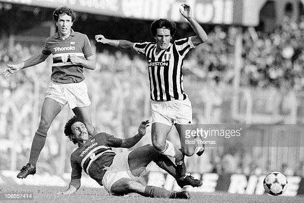 Gaetano Scirea of Juventus is brought down by Sampdoria defender Salvatore Vullo watched by Maggiora during their Serie A match at the Stadio Luigi...