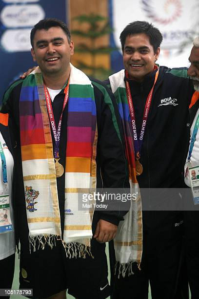 Gagan Narang and Imran Hasan Khan India's gold medalwinning marksmen in the Commonwealth Games' pairs 50metre rifle 3 positions show their medals at...