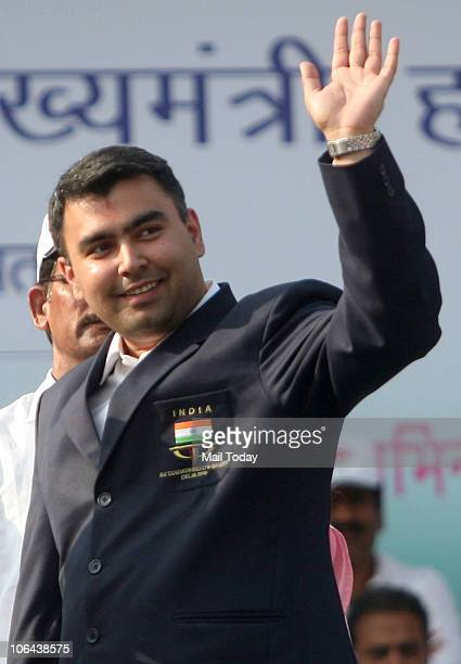 Gagan Narang greets the audience during a function to celebrate the 44th anniversary of the formation of Haryana in Sonepat Haryana on November 1 2010