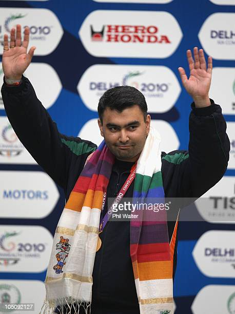 Gagan Narang of India celebrates his gold medal following the 50m Mens Rifle event at the Dr Karni Singh Shooting Range during day six of the Delhi...