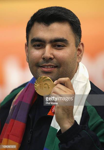 Gagan Narang of India poses with his gold medal following the 50m Mens Rifle event at the Dr Karni Singh Shooting Range during day six of the Delhi...