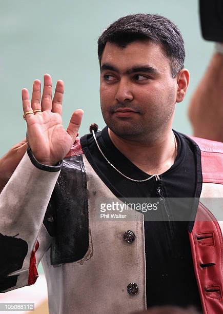 Gagan Narang of India waves following the 50m Mens Rifle event at the Dr Karni Singh Shooting Range during day six of the Delhi 2010 Commonwealth...