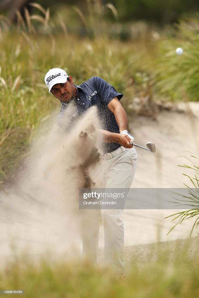 Gaganjeet Bhullar of India plays a shot from the bunker during day one of the World Cup of Golf at Royal Melbourne Golf Course on November 21, 2013 in Melbourne, Australia.