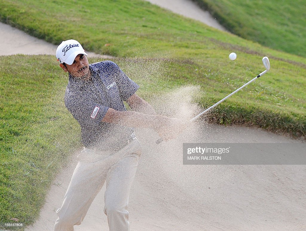 Gaganjeet Bhullar of India plays from the bunker at the 15th hole during the WGC-HSBC Champions tournament held on the Olazabal Course at the Mission Hill Golf Club in Dongguan on November 4, 2012. Els finished on 19 under par. AFP PHOTO/Mark RALSTON