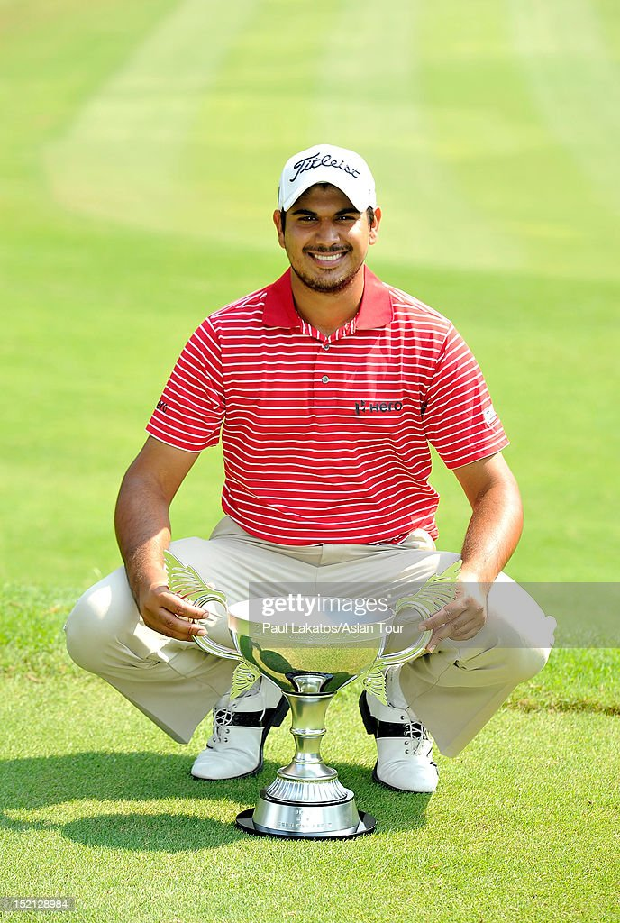 Gaganjeet Bhullar of India poses with the winner's trophy on the second day of round four of the Yeangder Tournament Players Championship at Linkou lnternational Golf and Country Club on September 17, 2012 in Taipei, Taiwan.