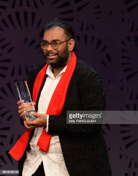 Gaggan Anand holds his trophy after winning the Best Restaurant in Asia award at the World's 50 Best Restaurants awards in Melbourne on April 5 2017...