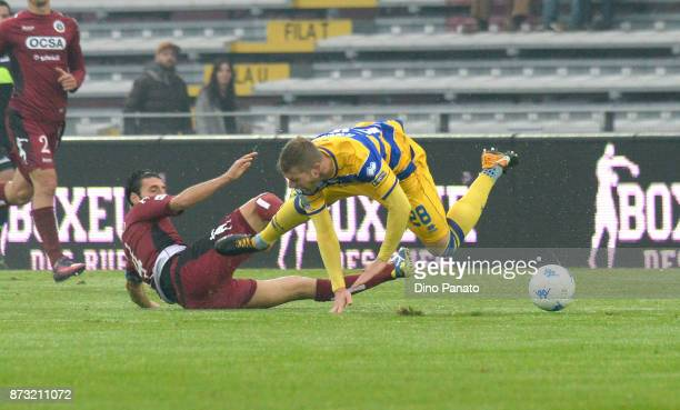 Gagliolo of Parma Calcio is tackled during the Serie B match between AS Cittadella and Parma Calcio on November 12 2017 in Cittadella Italy