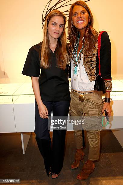 Gaia Repossi and Anna Dello Russo attend the Repossi for Colette Coktail Party at Colette on March 5 2015 in Paris France