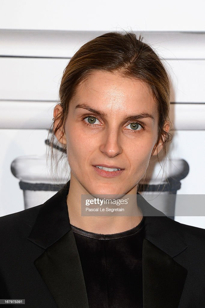 Gaia Repossi poses during a photocall for 'N°5 Culture Chanel' exhibition at Palais De Tokyo on May 3, 2013 in Paris, France.