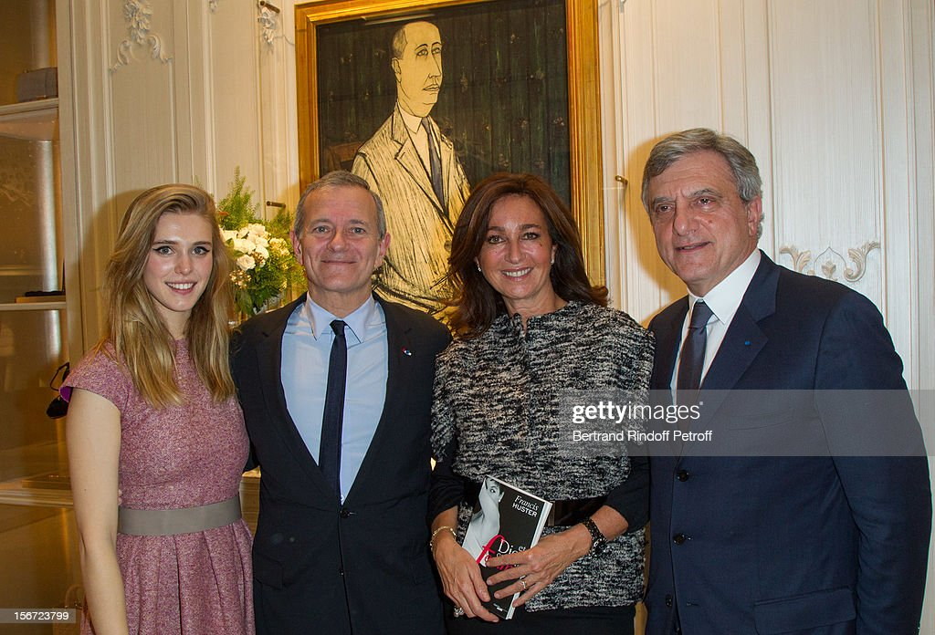 Gaia Weiss, Francis Huster, Katia Toledano and her husband Sidney Toledano, CEO of Christian Dior, attend the signing of Huster's book 'And Dior Created Woman' at Dior Boutique on November 19, 2012 in Paris, France.
