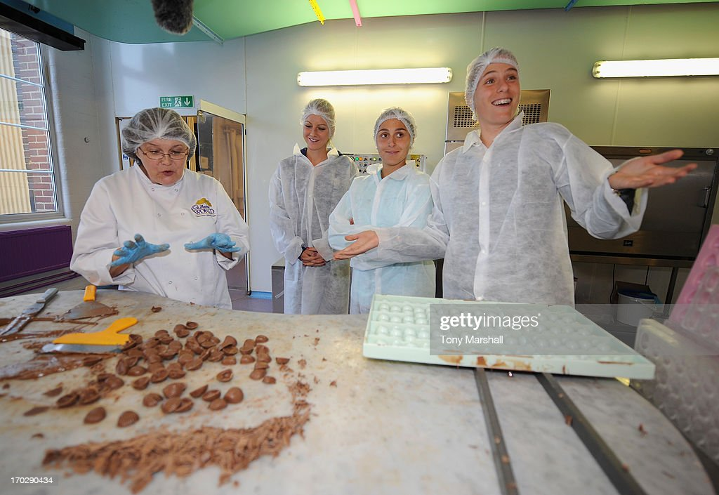Gail Deeley of Cadbury's, Urszula Radwanska of Poland, Tamira Paszek of Austria and Johanna Konta of Great Britain during their behind the scenes VIP Experience helping the chocolatiers at Cadbury World during The AEGON Classic Tennis Tournament at Edgbaston Priory Club on June 10, 2013 in Birmingham, England.