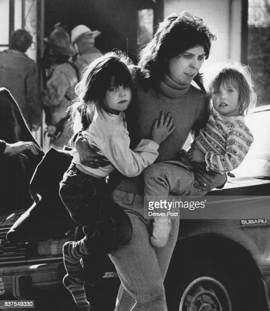 Gail Hendricks carries her daughters Alecia and Lyndsay from the scene of a fire in their home at 3510 W Wesley about 1130 today One of the children...