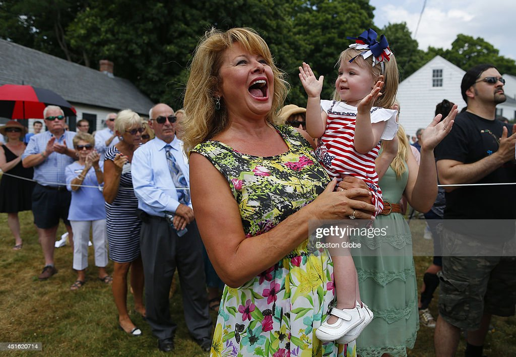 Gail Huff holds her 20-month-old niece Anna Lee Stohl as the two cheer following the singing of the national anthem at a campaign event for her husband Scott Brown at Bittersweet Farm in Stratham, New Hampshire July 2, 2014.