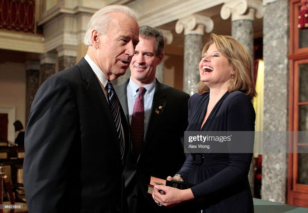 Gail Huff (R), wife of U.S. Senator Scott Brown (R-MA) (C), laughs as Brown participates in a ceremonial swearing-in with Vice President <a gi-track='captionPersonalityLinkClicked' href=/galleries/search?phrase=Joseph+Biden&family=editorial&specificpeople=206897 ng-click='$event.stopPropagation()'>Joseph Biden</a> (L) February 4, 2010 on Capitol Hill in Washington, DC. Brown was sworn in as the newest member of the U.S. Senate after winning a special election for the seat that was held by the late Sen. Edward Kennedy (D-MA).