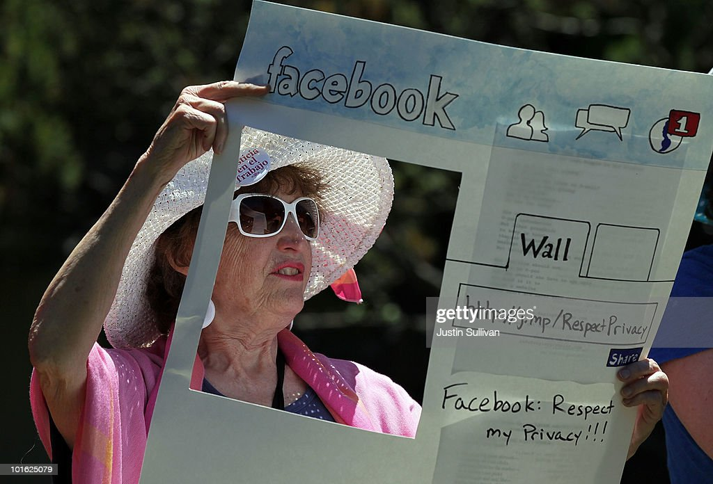 Gail Sredanovic of the group Raging Grannies holds a sign depicting a Facebook page as she protests outside of the Facebook headquarters June 4, 2010 in Palo Alto, California. The group was calling for the FTC to investigate FaceBook's privacy policies.