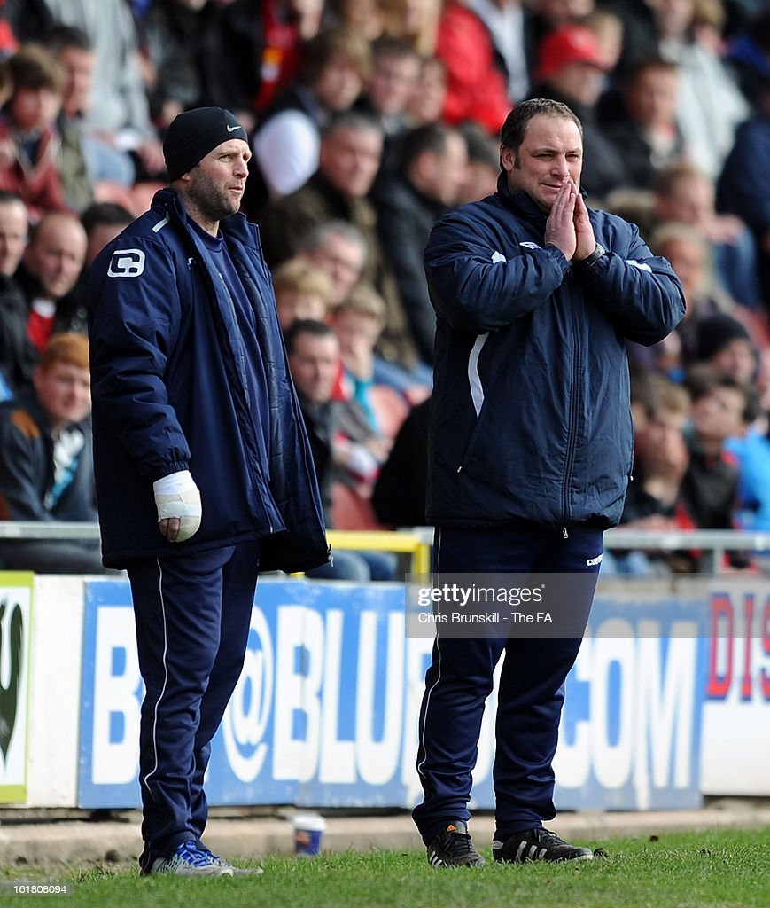 Gainsborough Trinity manager Steve Housham (R) looks on during the FA Trophy Semi-Final match between Wrexham and Gainsborough Trinity at the Racecourse Ground on February 16, 2013 in Wrexham, Wales.