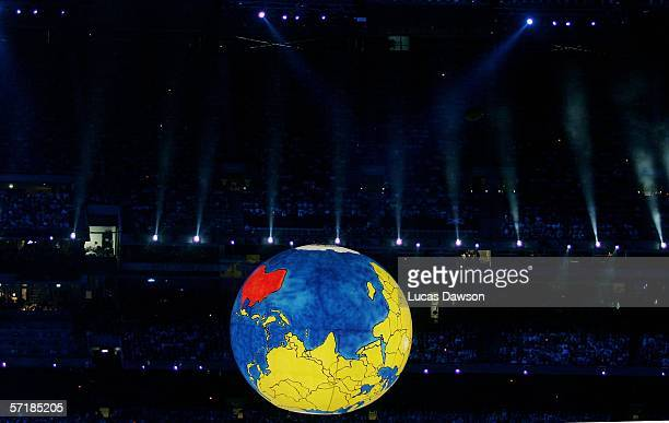 A gaint upsidedown globe reprenting Australia being on top of the world is lowered into the centre of the stadium as each of the competing country...