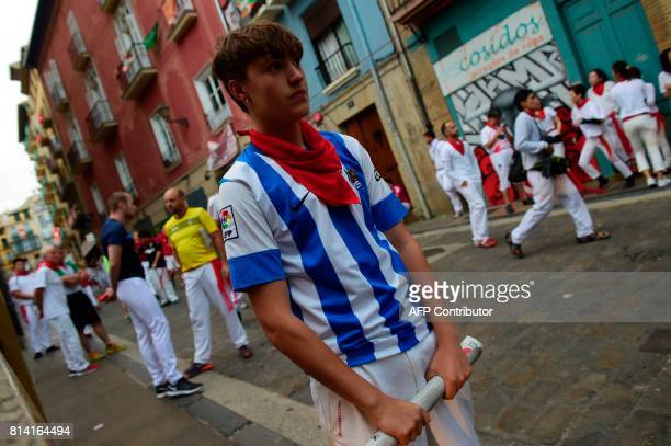 Gaizka Martinez 18 yearold waits for the Miura's fighting bulls before the eighth and last bull run of the San Fermin festival in Pamplona northern...