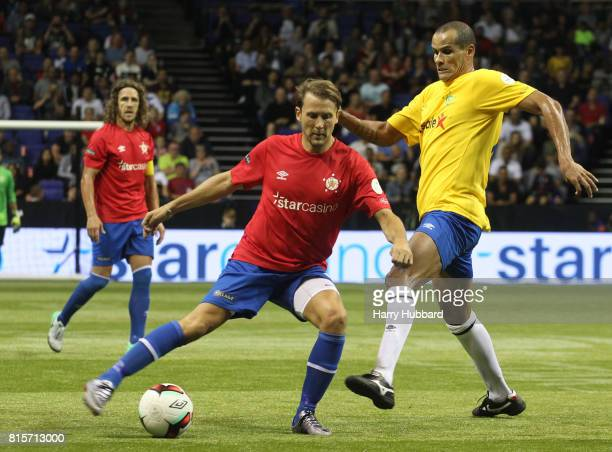 Gaizka Mendieta of Spain and Rivaldo of Brazil in action during the 3rd Place Play off Star Sixes match between Spain and Brazil at The O2 Arena on...