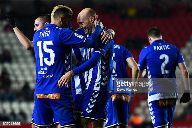 Gaizka Toquero of Deportivo Alaves celebrates with his team mate Theo Hernandez of Deportivo Alaves after scoring his team's first goal during the...