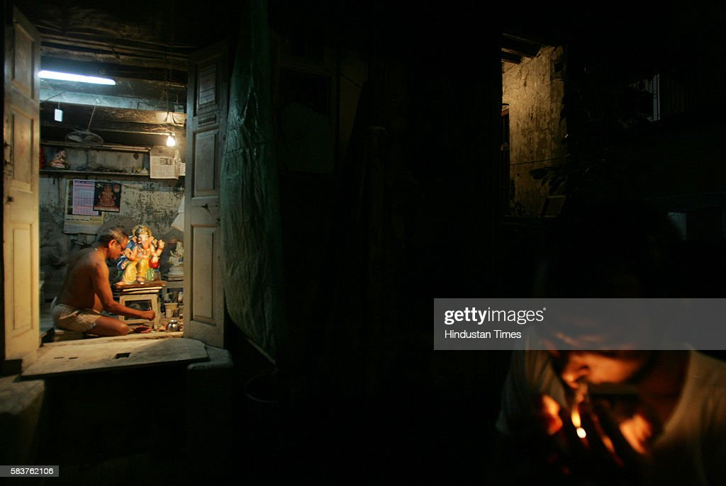 Gajanan Patkar Mill worker who lost his job three years ago paints a Ganpati idol in his house at Mazgaon The building that he lives in Prabhudas...