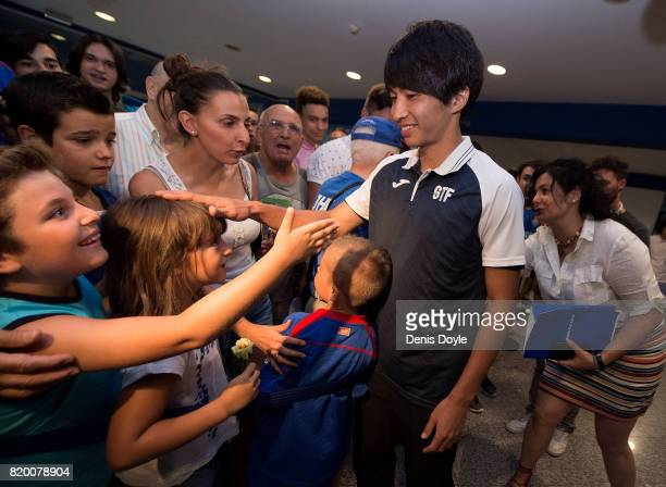 Gaku Shibasaki greets fans during his unveiling to the press as a new signing for newly promoted La Liga team Getafe CF SAD at Coliseum Alfonso Perez...