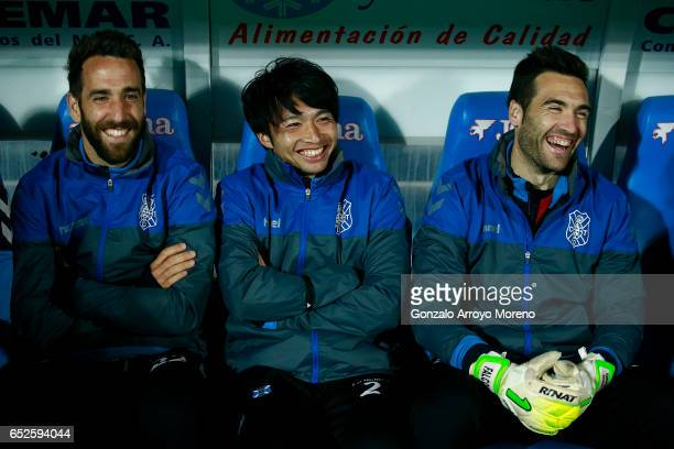 Gaku Shibasaki jokes with his teammates sitted on the bench prior to start the La Liga second league match between Getafe CF and Tenerife SAD at...