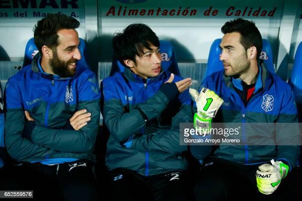 Gaku Shibasaki jokes with his Tenerife teammates on the bench prior to start the La Liga second league match between Getafe CF and Tenerife SAD at...