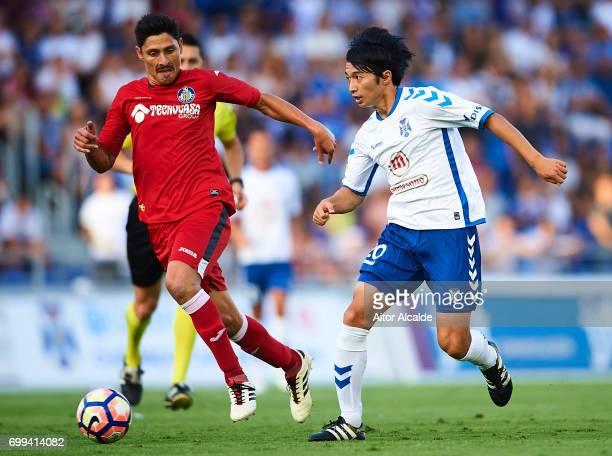 Gaku Shibasaki of CD Tenerife being followed by Alejandro Faurlin of Getafe CF during La Liga 2 play off round between CD Tenerife and Getafe CF at...
