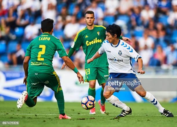 Gaku Shibasaki of CD Tenerife being followed by Javier Carpio and Ager Aketxe of Cadiz during La Liga 2 play off round between CD Tenerife and at...