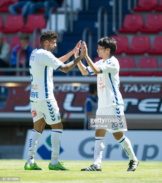 Gaku Shibasaki of CD Tenerife celebrates with Inigo Perez after Tenerife scored their 1st goal in the La Liga Segunda Division match between CD...