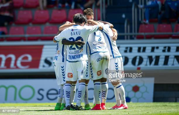 Gaku Shibasaki of CD Tenerife celebrates with teammates after Tenerife scored their 1st goal in the La Liga Segunda Division match between CD...