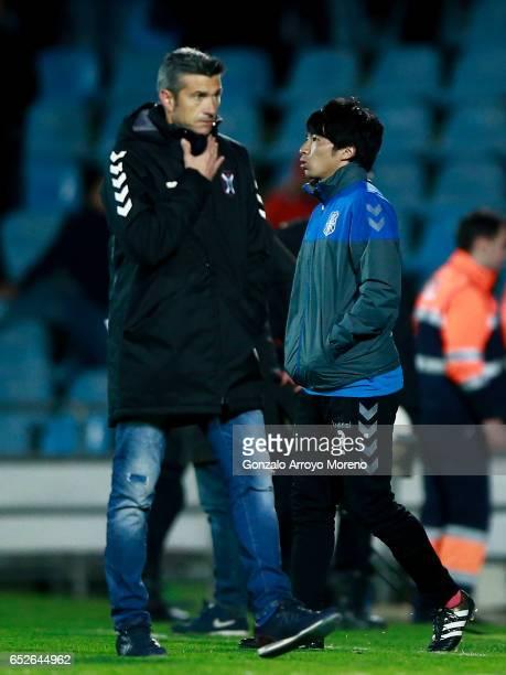 Gaku Shibasaki of CD Tenerife enters the pitch behind his coach Jose Luis Marti after the La Liga second league match between Getafe CF and CD...