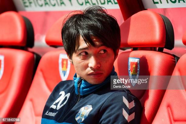 Gaku Shibasaki of CD Tenerife looks on from the bench before the La Liga Segunda Division match between CD Numancia and CD Tenerife at Estadio Los...