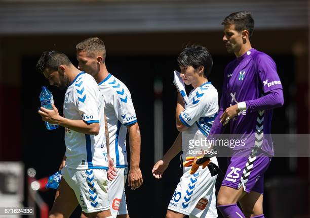 Gaku Shibasaki of CD Tenerife reacts with teammates after his team drew 11 in the La Liga Segunda Division match between CD Numancia and CD Tenerife...