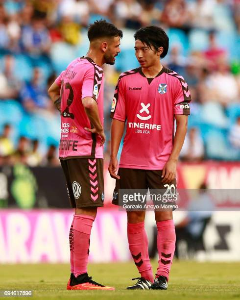 Gaku Shibasaki of CD Tenerife speaks with his teammate Tyronne del Pino alias Tayron during the La Liga 2 match between Real Zaragoza and CD Tenerife...