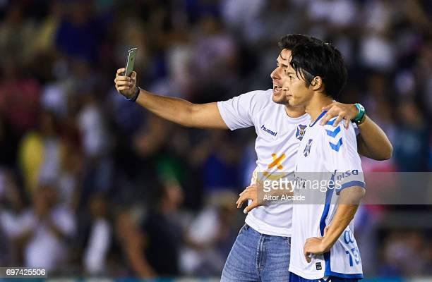 Gaku Shibasaki of CD Tenerife takes a selfie with a fan during La Liga 2 play off round between CD Tenerife at Heliodoro Rodriguez Lopez Stadium on...