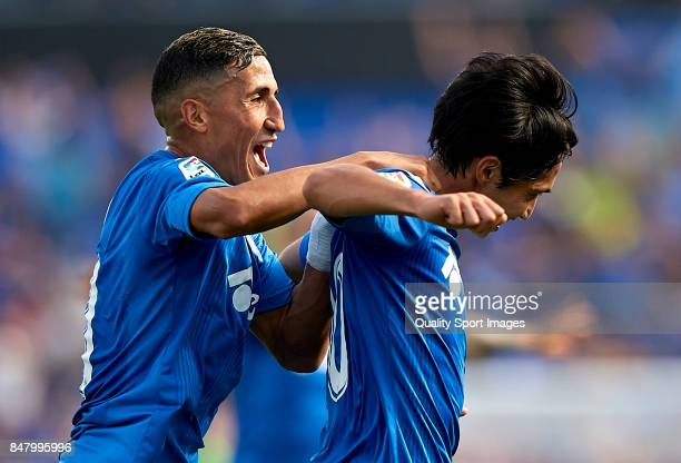 Gaku Shibasaki of Getafe celebrates scoring his team's first goal with his teammate Faycal Fajr during the La Liga match between Getafe and Barcelona...