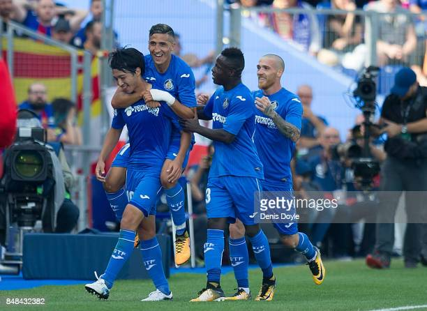 Gaku Shibasaki of Getafe celebrates with teammates after scoring his team's opening goal during the La Liga match between Getafe and Barcelona at...