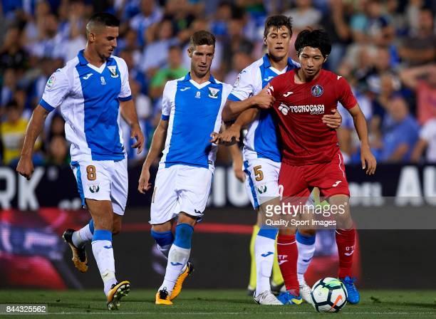 Gaku Shibasaki of Getafe competes for the ball with Martin Maximiliano Mantovani of Leganes during the La Liga match between Leganes and Getafe at...