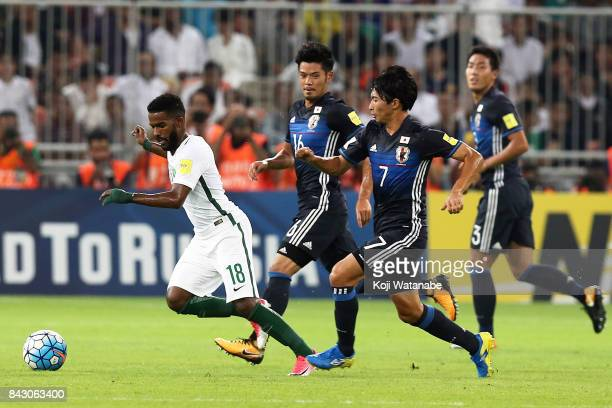 Gaku Shibasaki of Japan in action during the FIFA World Cup qualifier match between Saudi Arabia and Japan at the King Abdullah Sports City on...