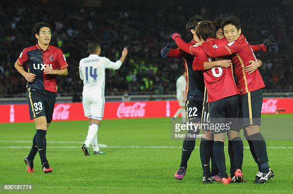 Gaku Shibasaki of Kashima Antlers celebrates scoring a goal with team mates during the FIFA Club World Cup final match between Real Madrid and...