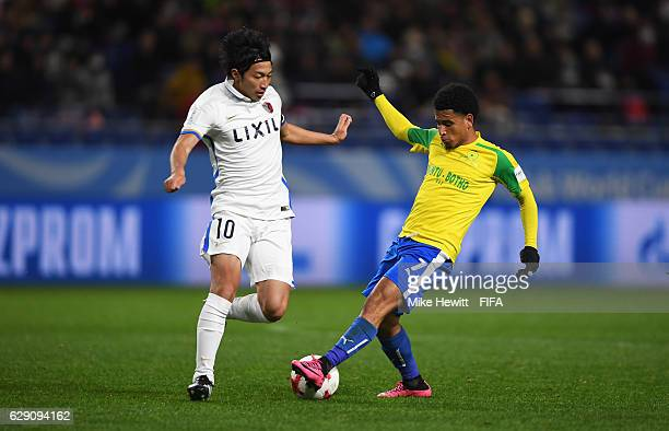 Gaku Shibasaki of Kashima Antlers challenges Keagan Dolly of Mamelodi Sundowns during the FIFA Club World Cup second round match between Mamelodi...