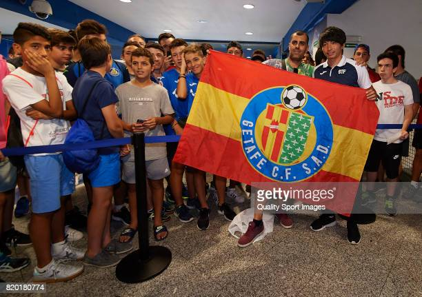 Gaku Shibasaki poses for a photograph with a fan during his presentation as a new player of Getafe CF at Coliseum Alfonso Perez on July 21 2017 in...