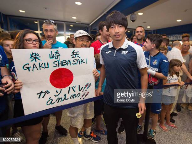 Gaku Shibasaki poses for a photograph with a fan during his unveiling to the press as a new signing for newly promoted La Liga team Getafe CF SAD at...