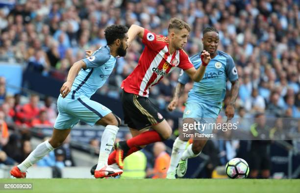 Ga'l Clichy and Raheem Sterling of Manchester City compete with Adnan Januzaj of Sunderland during the Barclays Premier League match between...