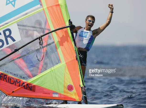 Gal Fridman of Israel celebrates winning his gold medal in the men's windsurfer mistral finals race on August 25 2004 during the Athens 2004 Summer...