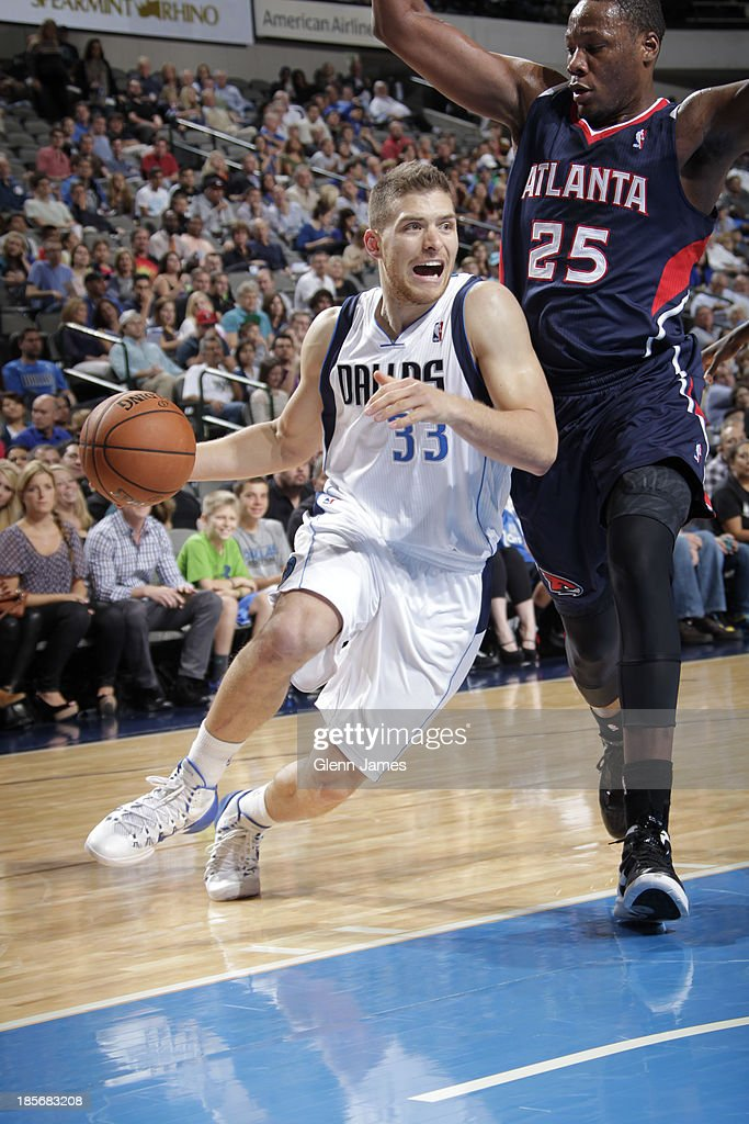 <a gi-track='captionPersonalityLinkClicked' href=/galleries/search?phrase=Gal+Mekel&family=editorial&specificpeople=6141738 ng-click='$event.stopPropagation()'>Gal Mekel</a> #33 of the Dallas Mavericks drives against Eric Dawson #25 of the Atlanta Hawks on October 23, 2013 at the American Airlines Center in Dallas, Texas.
